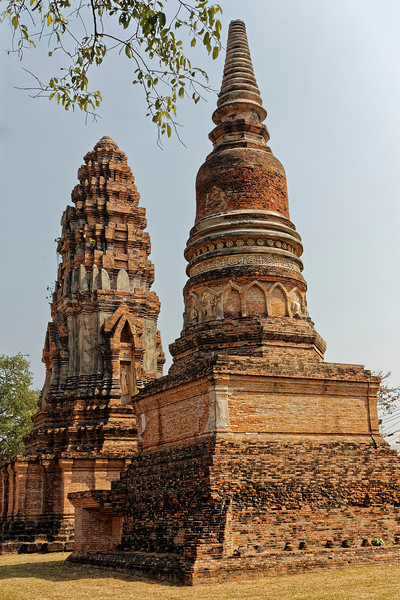 Most of the temple structures actually date from the reign of Narai (1657–1688). The tower seen in the background at left, though exhibiting later influences, is Khmer derived. The tower in the right foreground derives from Sri Lankan stupa designs.
