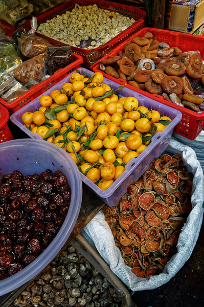 Oranges from China, candied jujube (left), bael (lower right), and dried nutmeg (upper right)