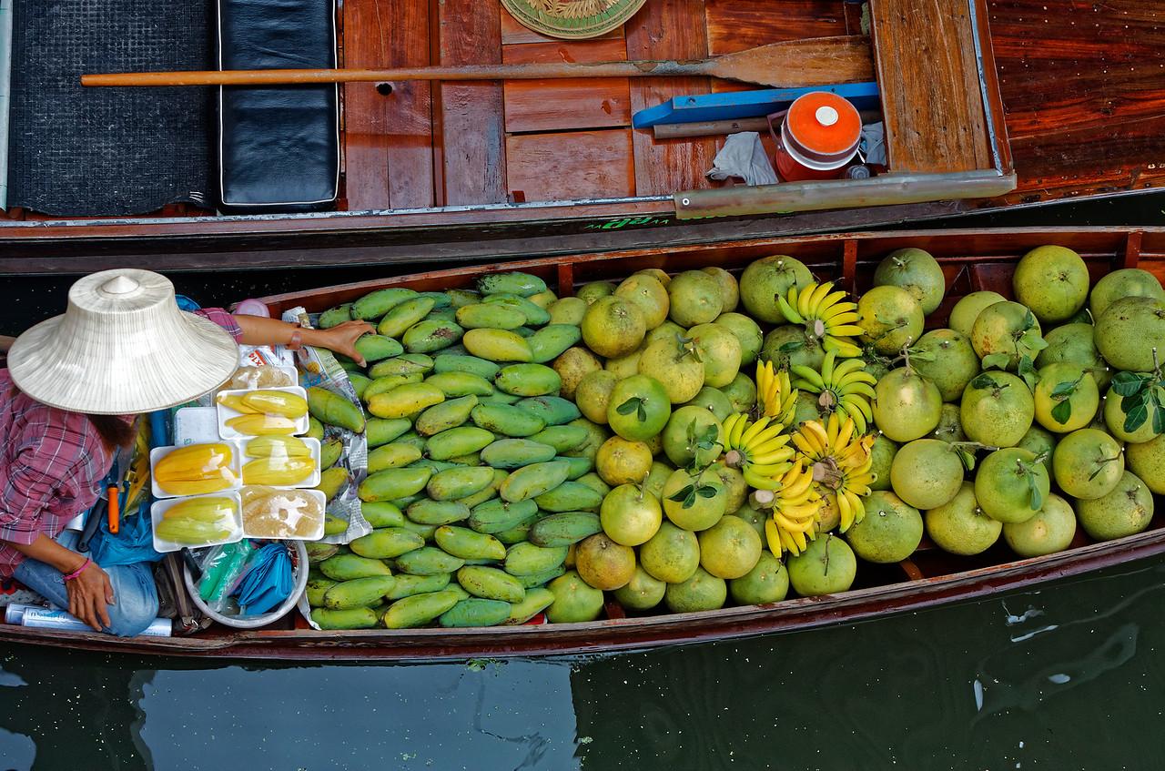 Fruit seller at Damnoen Saduak floating market
