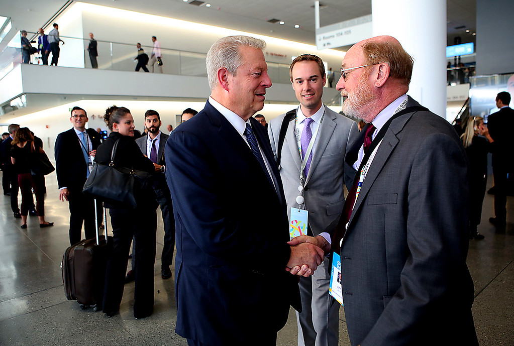. California Natural Resources Agency Secretary, and Santa Cruz resident, John Laird shares a word with former Vice President Al Gore in the lobby of the Moscone Center during the Global Climate Action Summit in San Francisco on Thursday. (Shmuel Thaler -- Santa Cruz Sentinel)