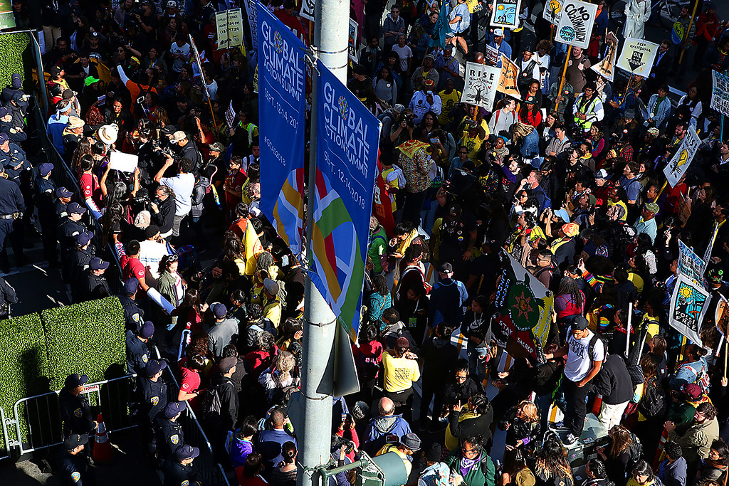. Protesters block an intersection adjacent to the Moscone Center in San Francisco on Thursday, saying their voices aren�t being heard at the Global Action Climate Summit.  (Shmuel Thaler -- Santa Cruz Sentinel)