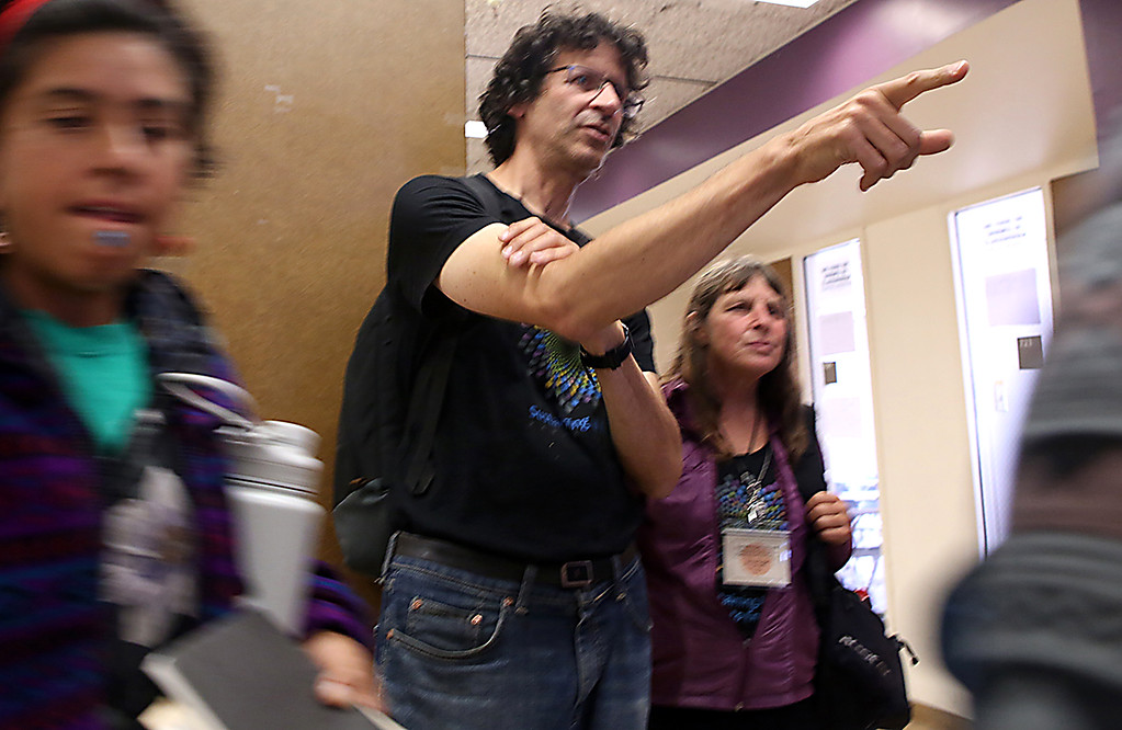 . limate activist Michael Levy, of Santa Cruz, helps direct foot traffic at the City College of San Francisco where he was helping to lead auxiliary events of the Global Action Climate Summit. (Shmuel Thaler � Santa Cruz Sentinel)