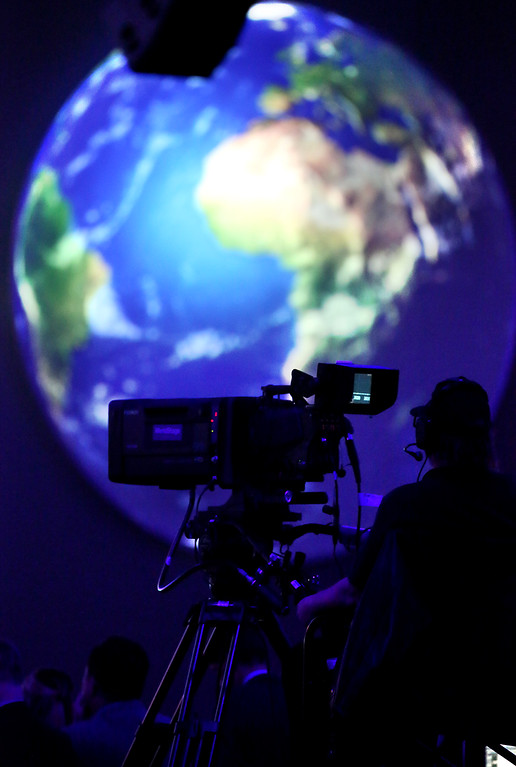 . One of the videographers working the live stream of the Global Climate Action Summit works in front of a projected image of the earth at the Moscone Center in San Francisco. (Shmuel Thaler � Santa Cruz Sentinel)