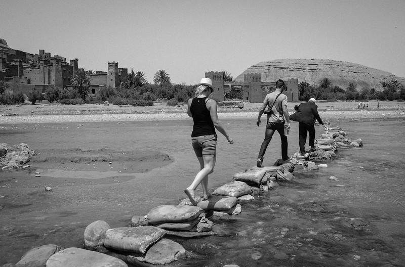 "Tourists follow Mouad across the ""bridge"""
