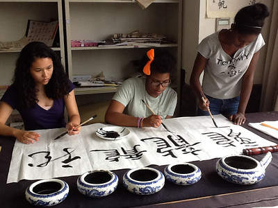 Brittany Bing '15, Jasmine Randle '15, and Taylor John '15 taking a calligraphy class