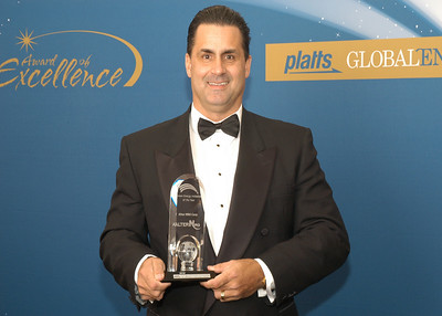 Mark Wright, Vice President of Sales and Marketing for Alter NRG Corp, accepts the 2010 award for Green Energy Initiative of the Year.