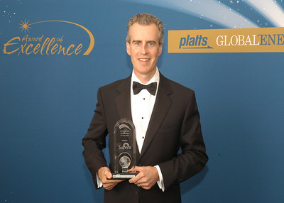 John Baumstark, CEO of Suniva, accepts the 2010 award for Commercial Technology of the Year.