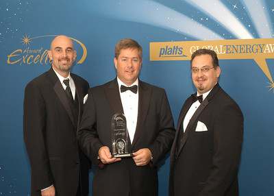 Shaun Davison, Director of Development, Jonathan Cook, COO and Mickey Watzak, Director - Projects for Excelerate Energy, accept the 2010 award for Downstream Operation of the Year.