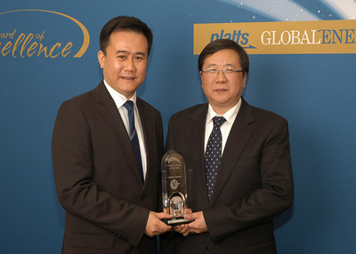 Yongzhi Jiang, Joint Company Secretary and General Manager of Investor Relations Department and Hua Yang, Vice Chairman and CEO of CNOOC Limited, accept the 2010 awards for Energy Company of the Year and Energy Producer of the Year.