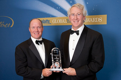 Jeff Mobley, Senior Vice President and Aubrey McClendon, CEO for Chesapeake Energy accept the Deal of the Year award in 2011.