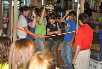 """Congratulations to the first team to check into Destination ImagiNation Global Finals 2011: The Triton Jr Sr High School High 5's from Bourbon, IN. The team """"cut the ribbon"""" and was presented an array of University of Tennessee goodies as Team Check In officially opened!"""