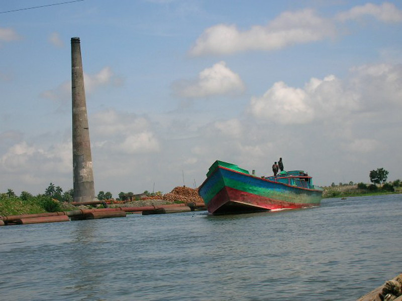 """Boating by a Brick Kiln"""