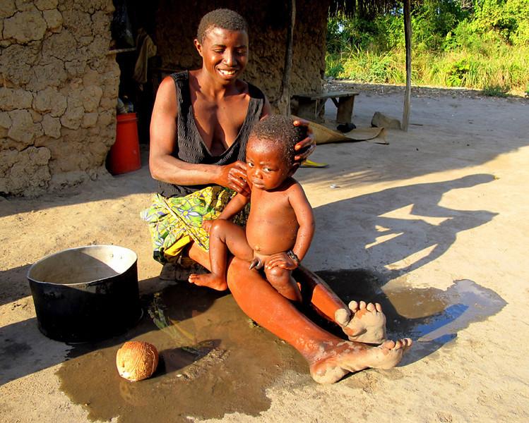 """""""Tatu Bathing her Son"""""""