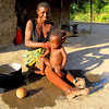 """Tatu Bathing her Son"""