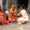 Courtney Peters<br /> Rollins School of Public Health <br /> <br /> Location: India<br /> <br /> This photo was taken in a rural Indian village, about eight hours away from Mumbai. It shows a Village Health Worker (VHW)/Mobile Health Team (MHT) member taking a high risk woman's blood pressure. This program is part of the Comprehensive Rural Health Project (CPHP), based out of Jamkhed, India. Project villages all have a VHW, and the MHT visits weekly. CRHP has revolutionized health outcomes in this part of Maharashtra state since its beginnings in the early 1970s.