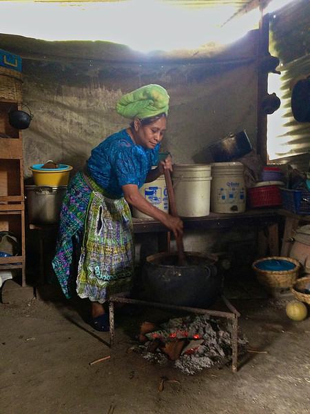 Aliza Lurie<br /> Nell Hodgson Woodruff School of Nursing<br /> <br /> Location: San Juan La Laguna, Guatemala<br /> <br /> This is my host grandmother cooking in a cauldron.  The special meal she cooked consisted of meat and took her more than 12 hours to make. It was the farewell dinner for the group.