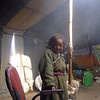 """A Tibetan girl stays in a tent filled with smoke"""