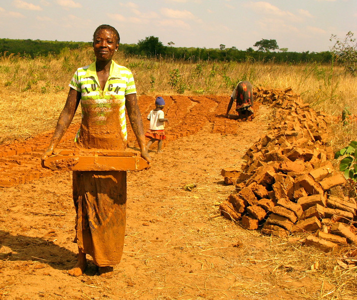 """""""A Mother Creating Bricks for her Child's School's Pit Latrine"""""""