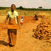 """A Mother Creating Bricks for her Child's School's Pit Latrine"""