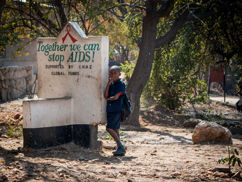 Vanessa Burrowes<br /> Rollins School of Public Health<br /> <br /> Location: Siavonga, Zambia<br /> <br /> Ranked at #6 overall, Zambia faces some of the highest HIV prevalence rates in the world.  Public health messages, such as the one shown here next to an elementary school in the small town of Siavonga, attempt to raise awareness of this disease, as well as encourage individuals to get HIV tested.