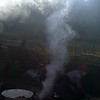 """Smoke from biomass combustion goes out through a hole on the top of the tent"""