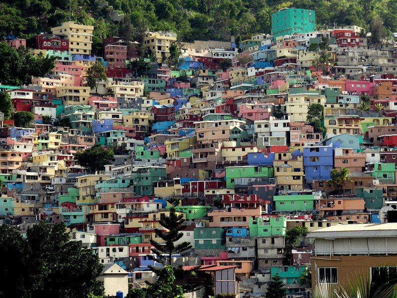 Anne Laterra<br /> Rollins School of Public Health<br /> <br /> Location: Port-au-Prince, Haiti<br /> <br /> Brightly painted houses of poured concrete slabs crowd each other for space on a hillside overlooking Port-au-Prince, Haiti.