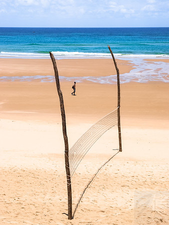 Boy walking at Inhambane Beach, Mozambique