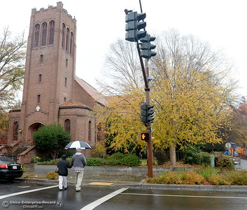 Rich Taboda and Susan Woodard of Oroville enjoy a stroll in the rain in downtown Chico, Calif. Tuesday Dec. 13, 2016. More rain is expected Wednesday. (Bill Husa -- Enterprise-Record)