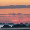 Misty mid-summer dawn on The Causeway