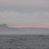 Misty sunset behind Bamburgh Castle