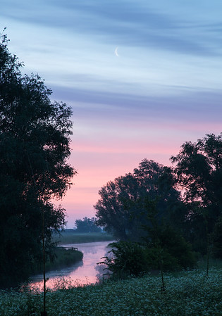 Crescent moon rises above River Great Ouse