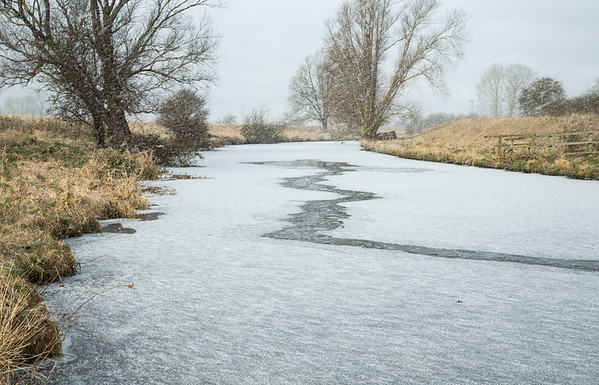 Snow and ice on the Old West River at Flat Bridge, Willingham, Cambridgeshire