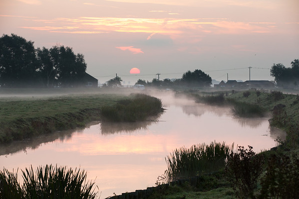 Sunrise through the mist on the River Great Ouse at Haddenham Engine Pumping Station, Cambridgeshire