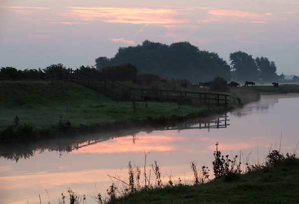 Sunrise over The Washes with reflections in the River Great Ouse