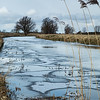 Reeds in a frozen Old West River near Flat Bridge, Willingham, Cambridgeshire