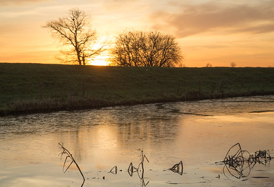Sunset reflections on a frozen river