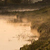 Mist rising from the River Great Ouse just after sunrise near Queenholme Farm.