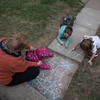 Desi Smith/Staff photo.   Neighbor Terri Risolo watches over Chloe Karcher 16 months and brother and sister Zachary 6, and Abby 5,as they played tic tac toe and draw, Saturday afternoon on Summit St in Rockport. April 25,2015