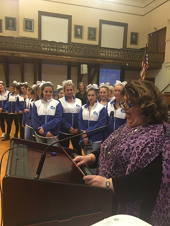 RAY LAMONT/Staff photo<br /> Mayor Sefatia Romeo Theken reads a city proclamation recognizing the achievements of the Gloucester High School cheerleading squad during Tuesday night's City Council meeting. The GHS cheerleaders had an successful 2016-17 season, which wrapped up last weekend with a first-place finish at a national competition in Orlando, Florida.