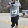JIM VAIKNORAS/Staff photo First female finisher Ciara Camire in the 5k race at the Fool's Dual Half Marathon and 5k.