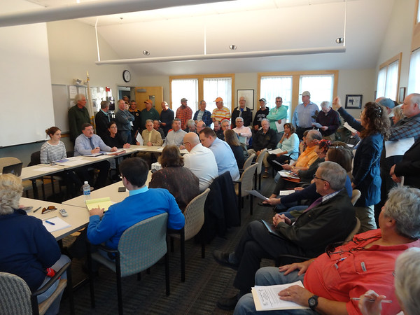 MARY MARKOS/Staff photo<br /> More than 100 people tried to fit in the Rockport Police station community room to hear a presentation on the possible extension of Granite Pier. The meeting had to be moved to the Rockport High cafeteria.