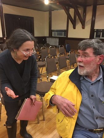 RAY LAMONT/Staff photo<br /> Gregg Zoske, left, chats with Alan MacMillan after the MBTA hearing in Gloucester on Wednesday night.