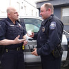 MARY MARKOS/Staff photo<br /> Essex police Sgt. Paul Francis, left, talks about the opioid reversal drug Narcan in the hand of xxx.