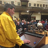RAY LAMONT/Staff photo<br /> Former MBTA train driver Alan MacMillan addresses audience at City Hall during hearing on announced weekend shutdowns this summer of the MBTA's Rockport line.