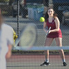 MIKE SPRINGER/Staff photo<br /> Gloucester's Tori Cabrini competes against a Saugus opponent during a varsity tennis match Monday in Gloucester.<br /> 4/23/2018