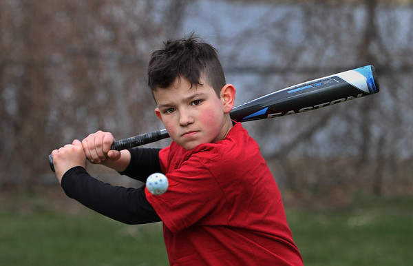 MIKE SPRINGER/Staff photo<br /> Ten-year-old Joseph Gucciardi prepares to hit a whiffle ball Tuesday during the Future Fishermen Little League Clinic in Gloucester. Sixty-five to 70 kids participated in the annual event, which was led by members of the Gloucester High School varsity baseball team.<br /> 04/17/2018