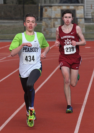MIKE SPRINGER/Staff photo<br /> Peabody's Shane Braz, left, edges out Matt Carter of Gloucester to win the two-mile run Tuesday in Gloucester.<br /> 4/10/2018