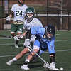 MIKE SPRINGER/Staff photo<br /> Triton's John D'Eufemia scoops up the ball as Jackson Rice, left, and Chrostopher Brosch of Manchester Essex look on during varsity lacrosse action Tuesday in Manchester.<br /> 4/24/2018