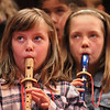 "MIKE SPRINGER/Staff photo<br /> Third-graders Emily Sly, left, and Isabella DaCruz play the recorder during a Rockport Elementary third grade concert Tuesday at the Shalin Liu Performance Center. The students, under the direction of music teacher Kaitlin Shaw-Reese, entertained their families with music ranging from Beethoven's ""Ode to Joy"" to a tune called ""Alfred the Alligator.""<br /> 4/3/2018"