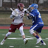 MIKE SPRINGER/Staff photo<br /> Gloucester's Brendan O'Brien, left, tries to move the ball past Kyle Little of Danvers during varsity lacrosse play Thursday in Gloucester.<br /> 4/19/2018